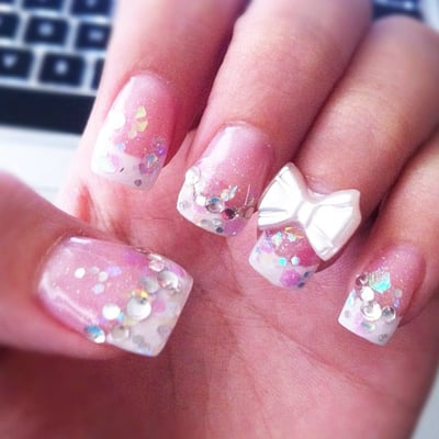 Acrylic nails. Glitter pink base w/ white french tip, rhinestones