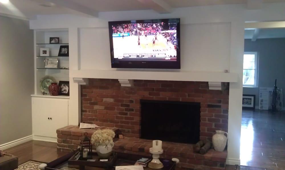 pioneer 52 plasma tv installed over brick fireplace on