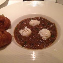 Porcini soup with quail eggs