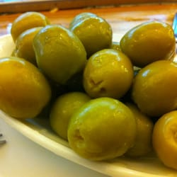 Fresh green olives come from the same tree as black olives (picked at a later time).