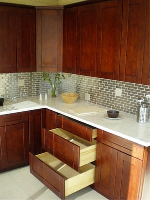 mahogany cabinets white carrera counters stainless steel