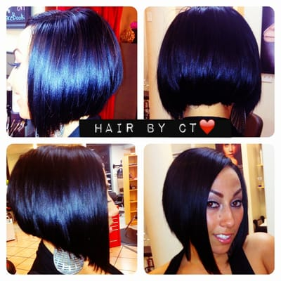 With natural part to the side and cut into asymmetrical bob by ct