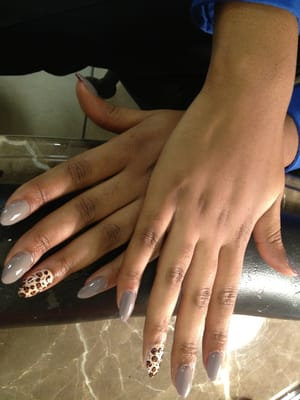 Stiletto nails with designs.