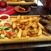 Hungarian meatballs with chips and salad