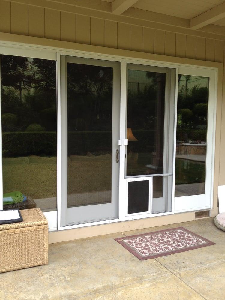 Sliding screen door with dog door