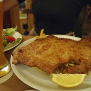 schnitzel in epic proportion! There are fries under there somewhere.