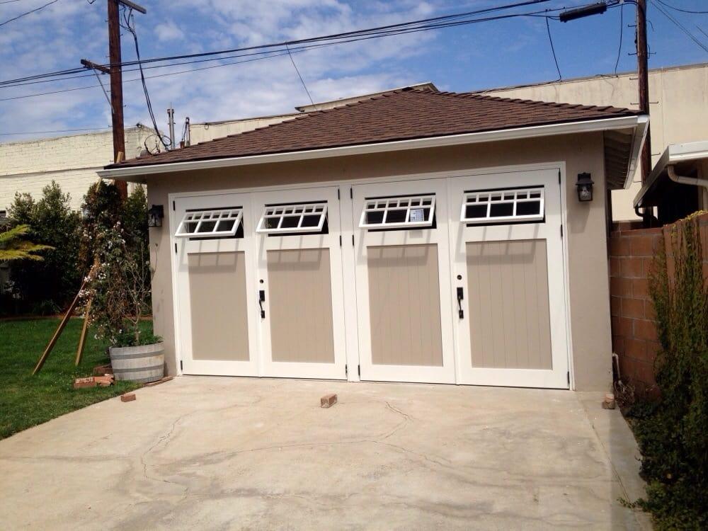 Swinging carriage garage door with functional windows yelp - Installing carriage style garage doors improve exterior ...