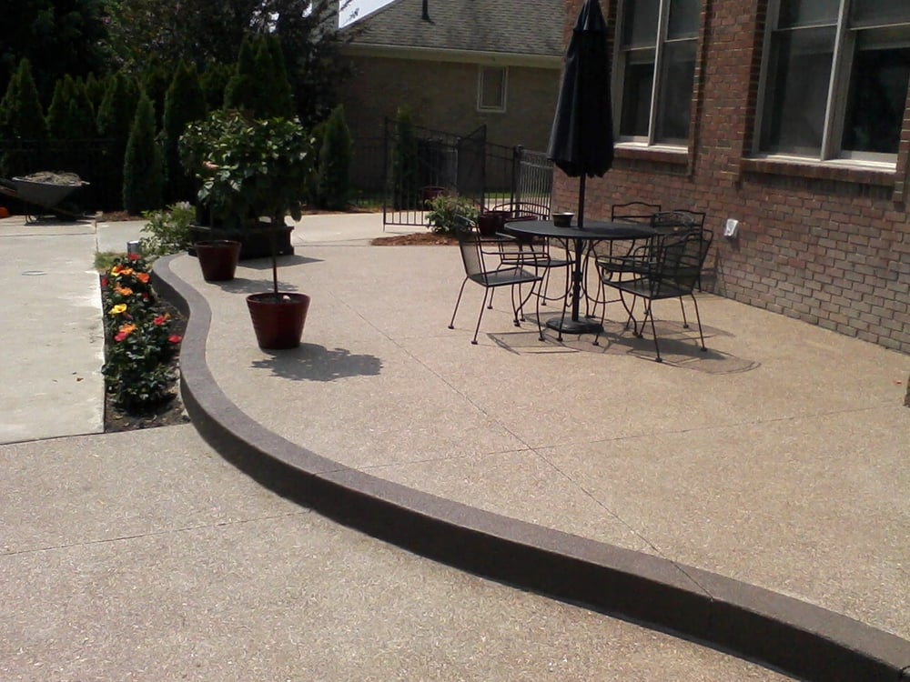 Raised Exposed Aggregate concrete patio with accent