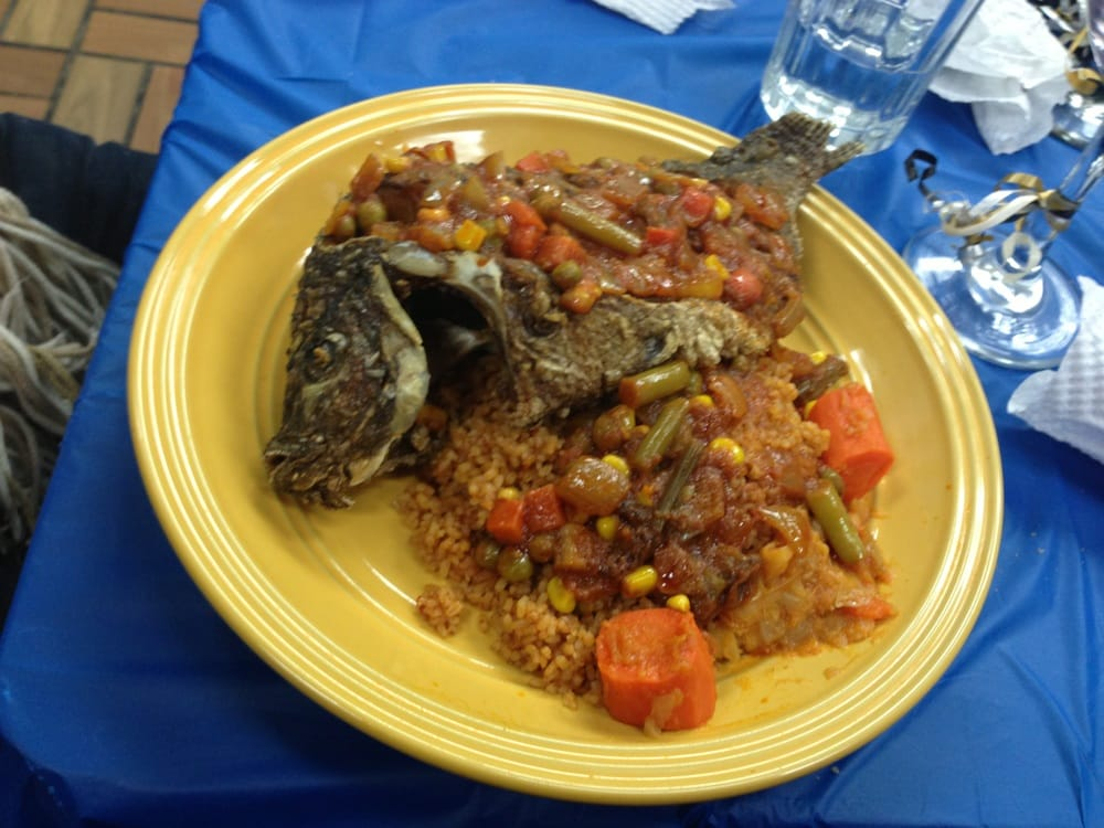 National dish of senegal djollof rice with whole fish yelp for Cuisine senegalaise