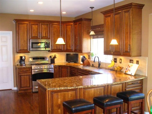 Burnished cherry cabinets granite countertops tile for New kitchen cabinets and countertops