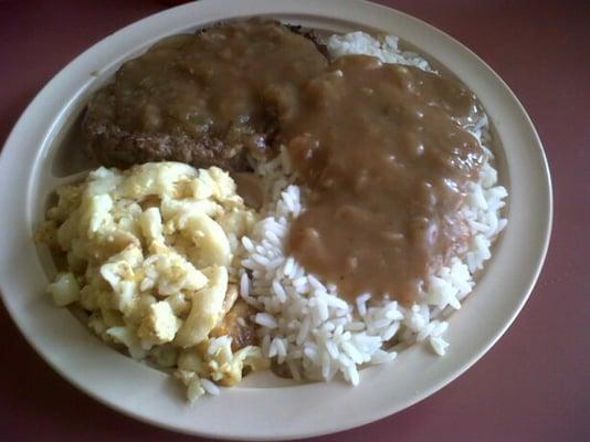 Hamburger steak with onions and gravy, rice and gravy, and macaroni ...