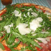 amazing pizza with tomato sauce, arugula, parmesan and Speck!