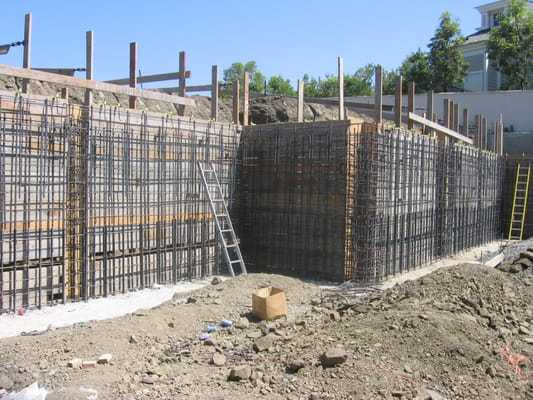 Steel set up for a retaining wall and footing Yelp
