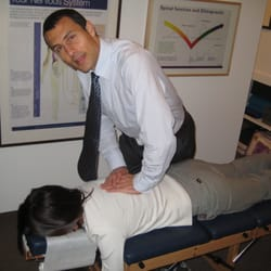 Dr Brian performing a chiropractic adjustment