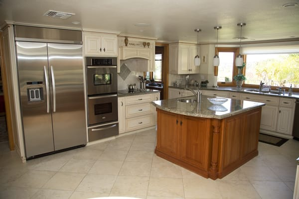Custom glazed cabinetry, Seafoam Green Granite, Tile flooring and