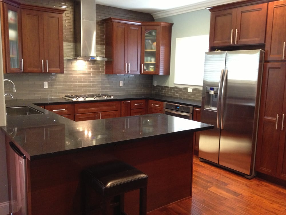 Kitchen Cabinets  american cherry, glass subway tile backsplash
