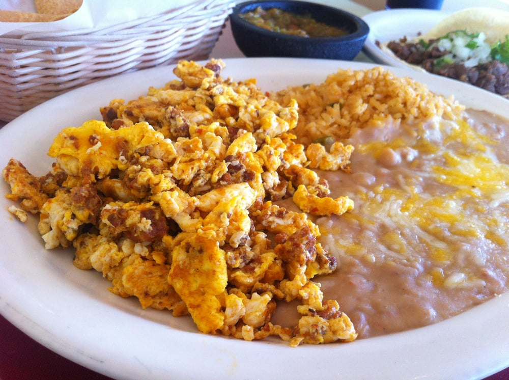 Eggs & chorizo, beans and rice. With a side of tacos. | Yelp