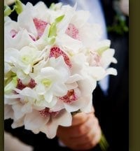 bridal bouquet of all white cymbidium orchids with throats