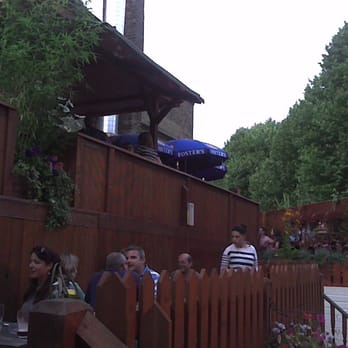 garden decking, reaching the roof of the pub