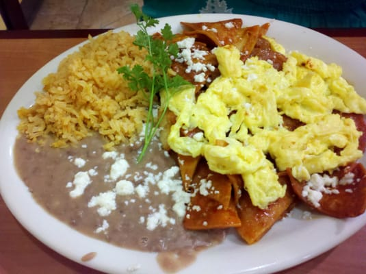 chilaquiles plate with rice beans and eggs | Yelp