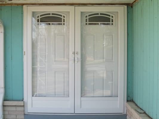 We replaced the double entry doors with new fiberglass for Double storm doors for french doors