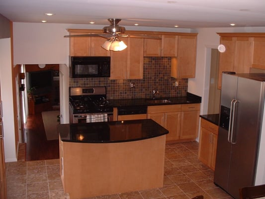 Complete kitchens: Maple cabinets, Limestone floor, slate