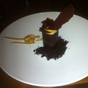 Chocolate soil with a chocolate and salted caramel cylinder with nut goo filling. MIND BLOWING and very very rich, which I like.