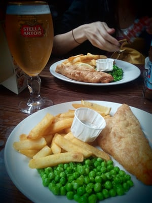 Gettin' my Fish 'n Chips on with Stella Artois.