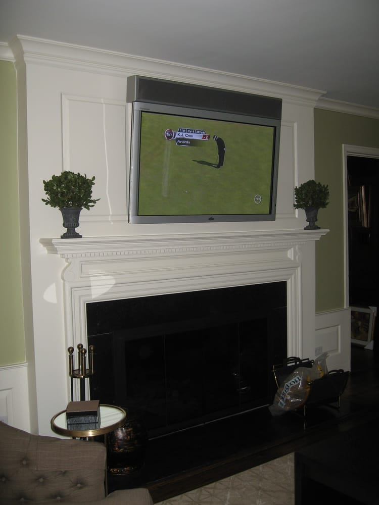 55 Television Mounted Over A Fireplace A Custom Made