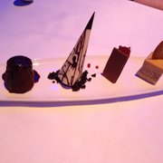 Chocolate plate. R-L (dark chocolate mint, white chocolate verbena, milk chocolate raspberry, blonde).