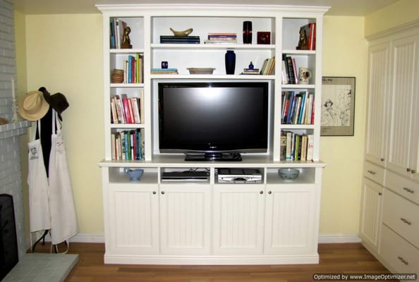 Custom entertainment unit using a combination of natural solid ...