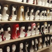 Wig area with 2 private fitting rooms.