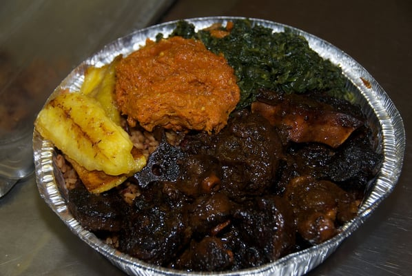 oxtail served with rice and peas fried plantains pumpkin