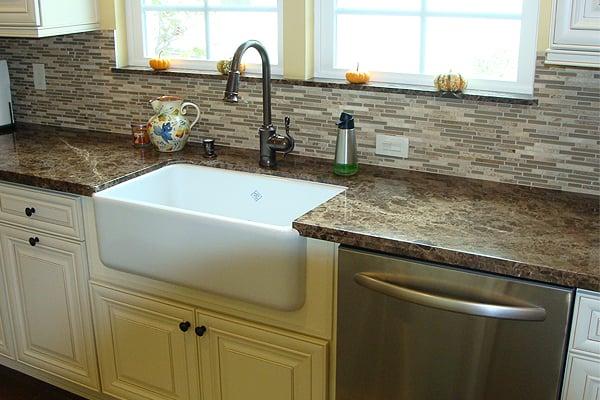 Apron sink on Emperador Marble countertops  Yelp