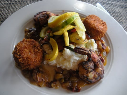 Crispy cornbread crab cakes with blackened colossal shrimp on top of ...