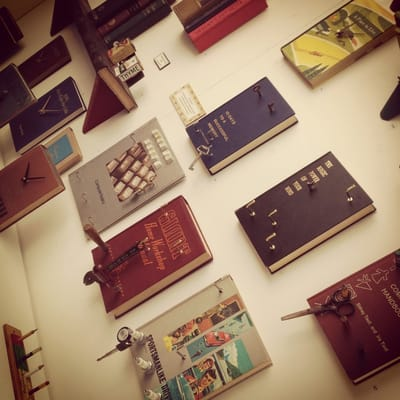 Cool--repurposing books for wall decor (clocks, hooks) | Yelp
