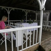 A wedding pianist playing the piano for an outdoor ceremony at Hunters Meet Hotel and Restaurant.