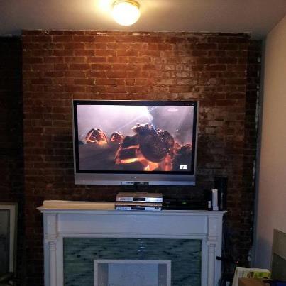 Brick Wall Mounted Tv On Tilt Mount Above Fireplace Yelp