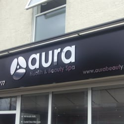mirror finished flat cut aluminium composite letters fixed using stand off locators to an aluminium composite sign tray