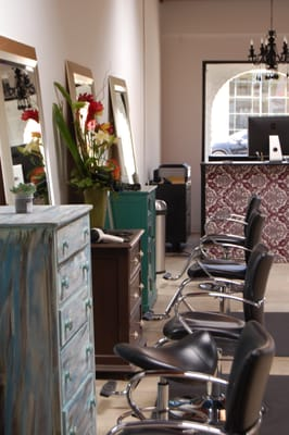 Our salon stations feature repurposed furniture by Bird Hair Designs.