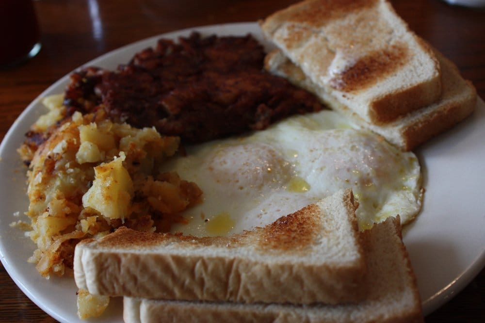 Eggs over easy with corned beef hash | Yelp