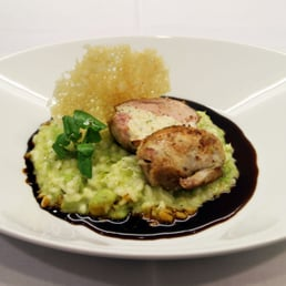 Roast Quail, tarragon and chive mousseline, pea and broad bean risotto.