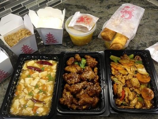 Ma po tofu, sesame chicken, and hunan chicken.   Yelp
