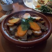 Gorgeous tender lamb tagine served with a big basket of bread