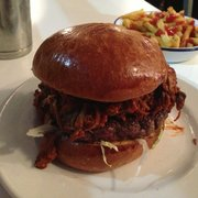 Pulled pork burger! A beef patty on lettuce, topped with pulled pork and Kansas City BBQ sauce.
