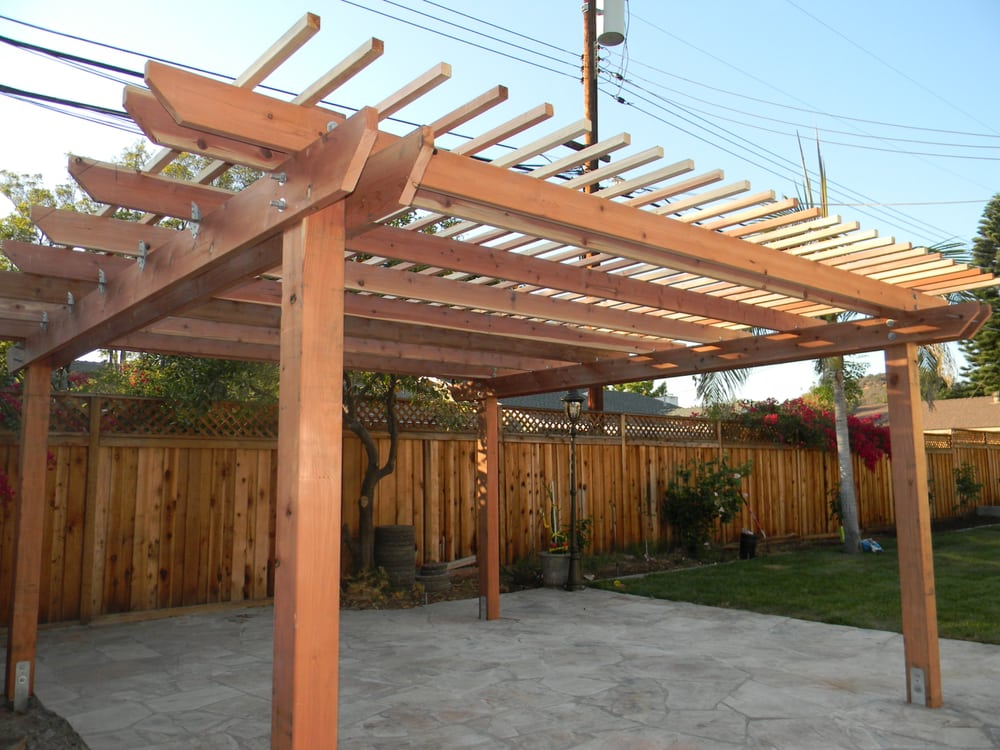 Redwood pergola and 7 5 foot fence with lattice on top yelp for Redwood patio cover