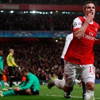 Arsenal's Robin van Persie celebrates his goal against Barcelona.