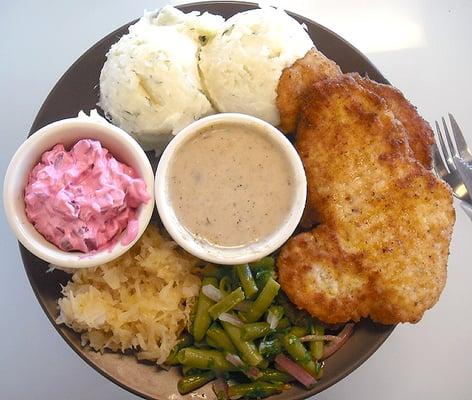 ... salad, sauerkraut, marinated green beans, and porcini mushroom gravy