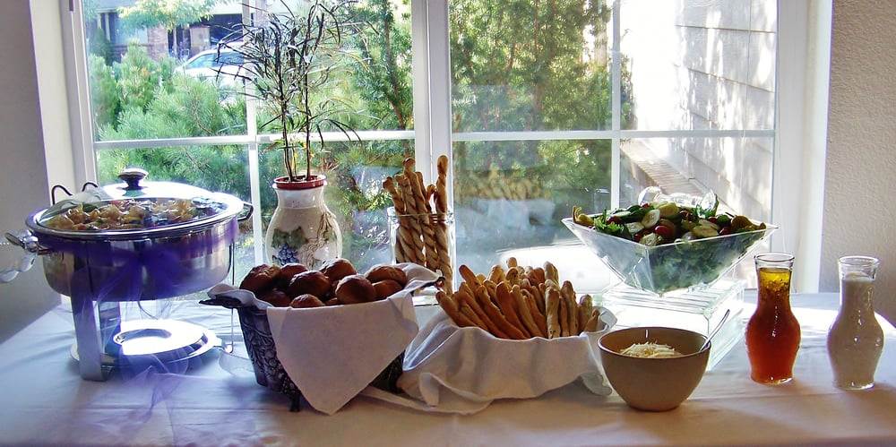 Salads and fresh bread sticks for pasta bar at wedding for Food bar wedding reception