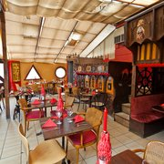 The Egyptian-themed 'Conservatory' area with booths and balconies - great for parties